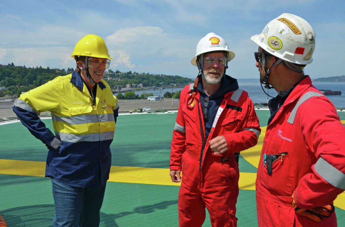 Ann Pickard speaks with Shell drilling foreman Scott Lapiene and Transocean's Jason Braquet on the helideck of the Polar Pioneer.
