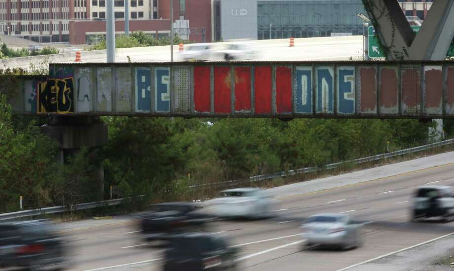 "A popular graffiti mural over I-45 near downtown that previously read ""BE SOMEONE"" is seen Friday, Aug. 7, 2015, in Houston. The mural was defaced and now reads, ""BE ONE."" Photo: Jon Shapley, Houston Chronicle / © 2015 Houston Chronicle"