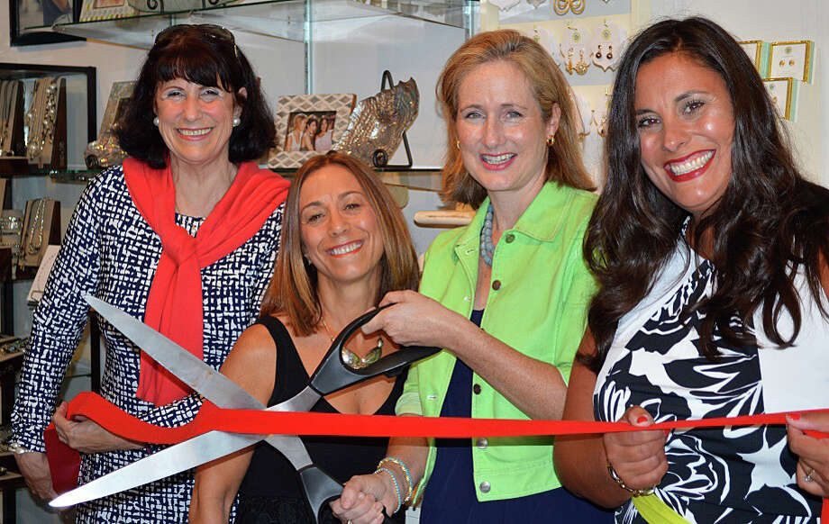 Me Boutique, featuring women's fashions and accessories, hosted a ribbon-cutting in Fairfield recently to mark its move to the Brick Walk Promenade on the Post Road in Fairfield. Pictured are, from left, Beverly Balaz, Fairfield Chamber of Commerce director; boutique co-owner Elena Garet; Selectman Sheila Marmion, and co-owner Michelle Merchant. Photo: Contributed Photo / Contributed Photo / Fairfield Citizen