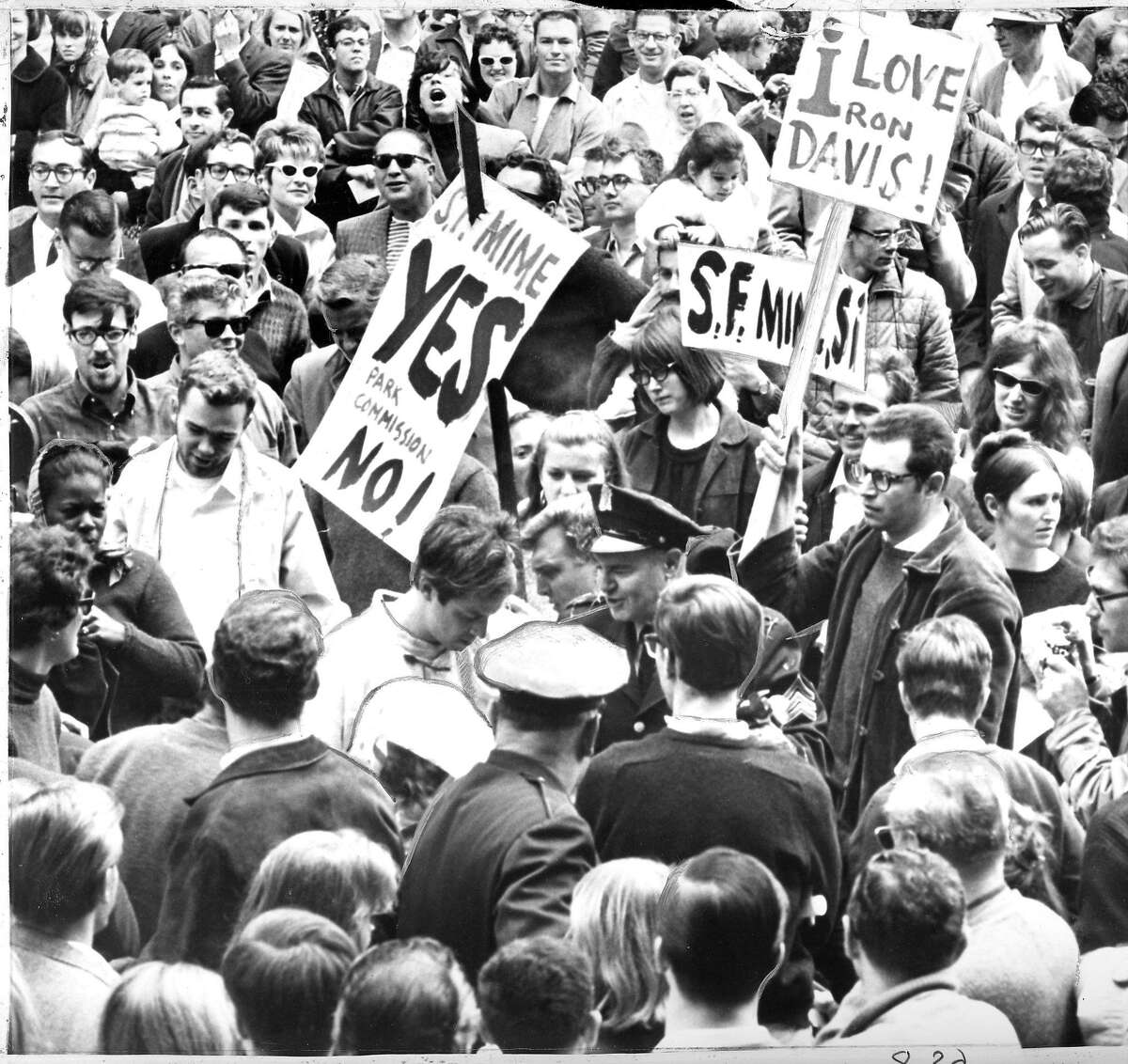 San Francisco Mime Troupe founder and director R.G. Davis (Ronald Davis) is arrested August 7, 1965, before a crowd of 1,000 that turned out to support the performance.