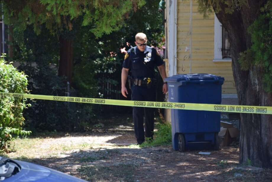Police investigate a scene on the city's East Side where workers at a home renovation site stumbled on a dead body. Photo: By Mark D. Wilson, San Antonio Express-News