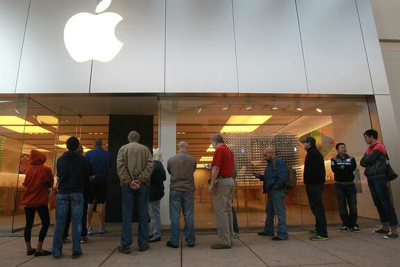 Customers line up for Apple products Friday November 1, 2013 at the Apple Store at the Shops at La Cantera. Apple is launching its new iPad Air November 1, 2013. The new device is 7.5 millimeters thin and weighs one pound and has a 9.7-inch Retina display.