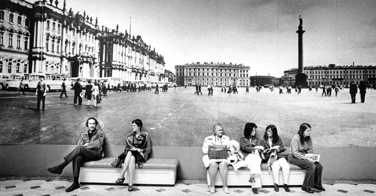Top: People rest in front of a photo of the Winter Palace in Leningrad during a major exhibit of Russian art at the Palace of the Legion of Honor museum in 1976. Above: A shark is on display near the Steinhart Aquarium at the old Academy of Sciences.