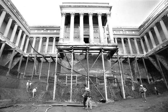A crew from Hansell Phelps Construction works 60 feet below main entrance of the Palace of Legion of Honor museum. They are constructing two additional floors beneath the museum and doing seismic upgrades five years after the Loma Prieta earthquake.