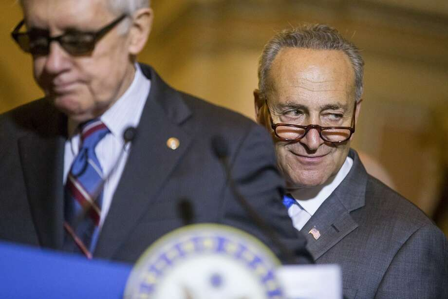 FILE-- Sen. Chuck Schumer (D-N.Y.) with Senate Minority Leader Harry Reid (D-Nev.) during a weekly news conference following a Senate policy luncheon on Capitol Hill in Washington, July 28, 2015. The decision by Schumer to oppose President Obama's deal to limit Iran's nuclear program rattled the Democratic firewall around the accord, but supporters said Democratic defections in New York and South Florida would not be enough to bring down the agreement. (Zach Gibson/The New York Times) Photo: Zach Gibson, New York Times
