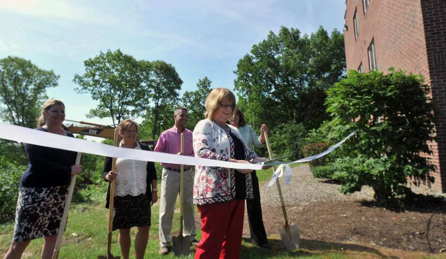 Menands Mayor Megan Grenier cuts the ribbon during the groundbreaking ceremony for Phase IV of Dutch Village on Friday, Aug. 7, 2015, at Dutch Village in Menands N.Y. (Phoebe Sheehan/Special to The Times Union) Photo: PS / 00032929A