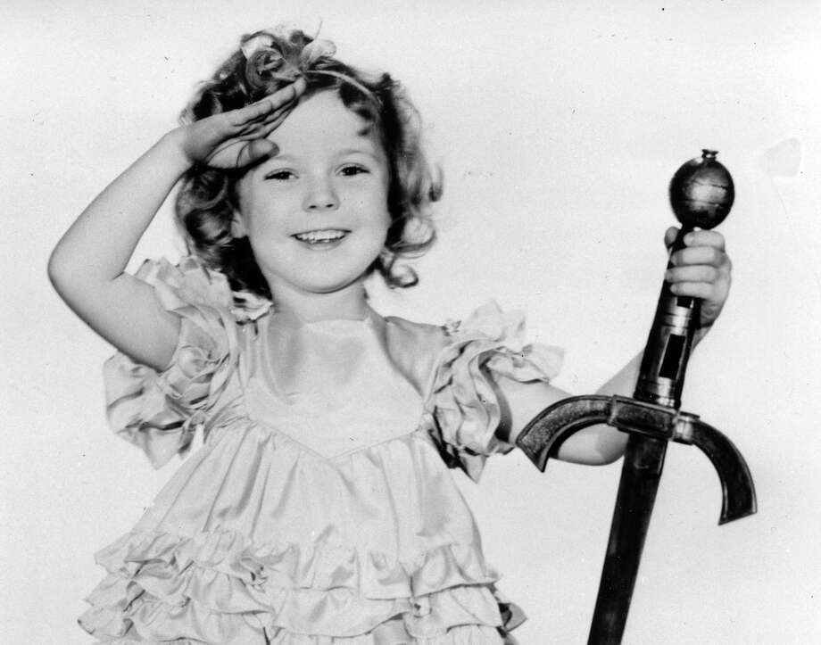 """A reader says he longs for the days when he could have taken his grandchildren to movies such as those starring Shirley Temple, a child star of the 1930s, without fear of exposing them to violence or profanity. Temple is pictured above in the 1933 film """"Little Miss Marker."""" Photo: Uncredited /Associated Press / AP"""