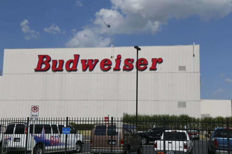 After allegedly robbing a Burger King restaurant, two men led Houston Police on a car chase which ended at the Budweiser plant in Interstate 10. Photo: James Nielsen, Houston Chronicle