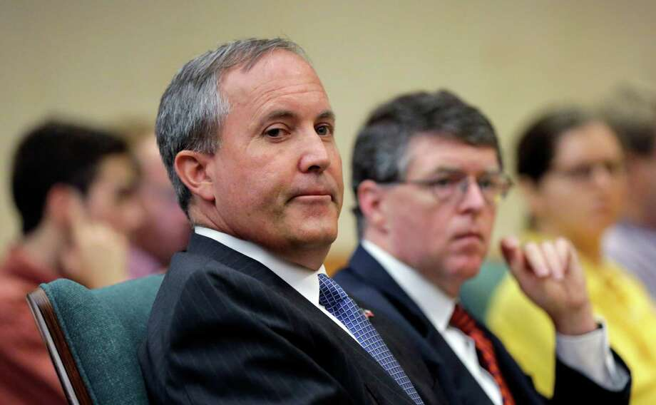Attorney General Ken Paxton (left), seen on July 29, 2015, in Austin, is among Texas officials who have bent the rules to hire at least 146 people with personal or political connections, state records show. Photo: Eric Gay /Associated Press / AP