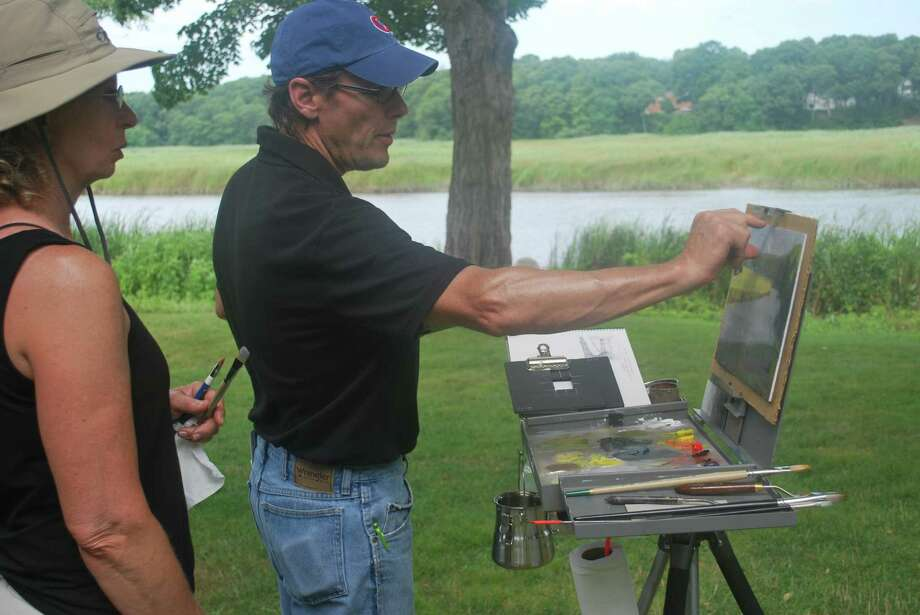Plein-air landscape painter T. Allen Lawson, right, demonstrates his technique at the Lyme Academy College of Fine Arts last week. Photo: Contributed Photo