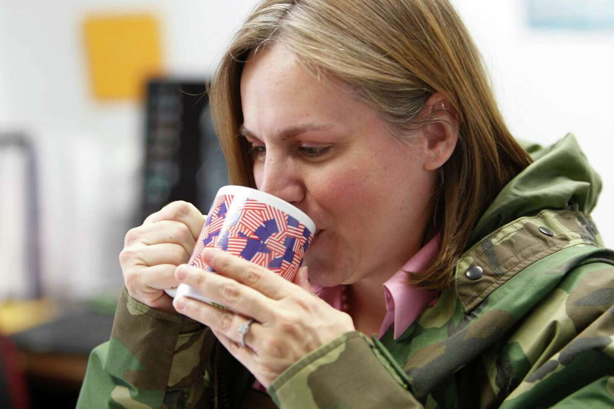 Director of Development of Worklife Institute Texas Veterans Program Rachel Ellen Bromley sips hot tea in her office Thursday, Aug. 6, 2015, in Houston. On most days Bromely wears a military jacket and drinks hot tea to stay warm in her office. She works in an office where the temperature never makes anybody happy. ( Steve Gonzales / Houston Chronicle )