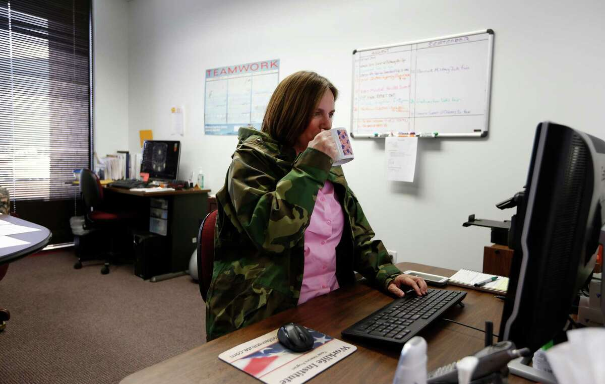 Director of Development of Worklife Institute Texas Veterans Program Rachel Ellen Bromley works in her office Thursday, Aug. 6, 2015, in Houston. On most days Bromely wears a military jacket and drinks hot tea to stay warm in her office. She works in an office where the temperature never makes anybody happy. ( Steve Gonzales / Houston Chronicle )
