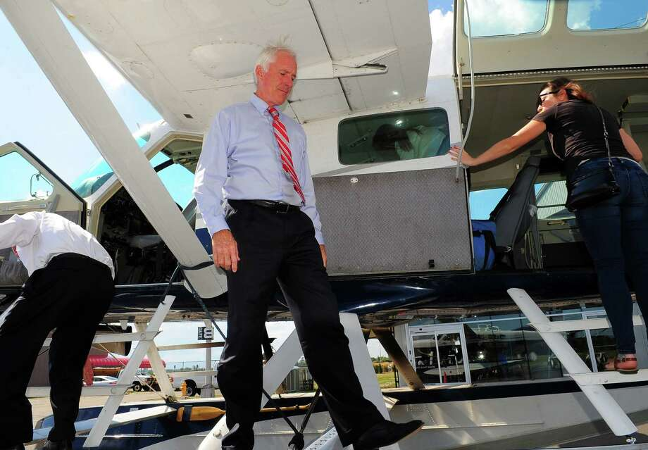Bridgeport Mayor Bill Finch boards one of Tailwind's sea planes at its terminal at Sikorsky Memorial Airport in Stratford, Conn., on Wednesday Aug. 5, 2015. Tailwind will be offering amphibious plane service to the East River in NYC, and will connect Bridgeport with other cities such as Boston and Philadelphia. Photo: Christian Abraham / Hearst Connecticut Media / Connecticut Post