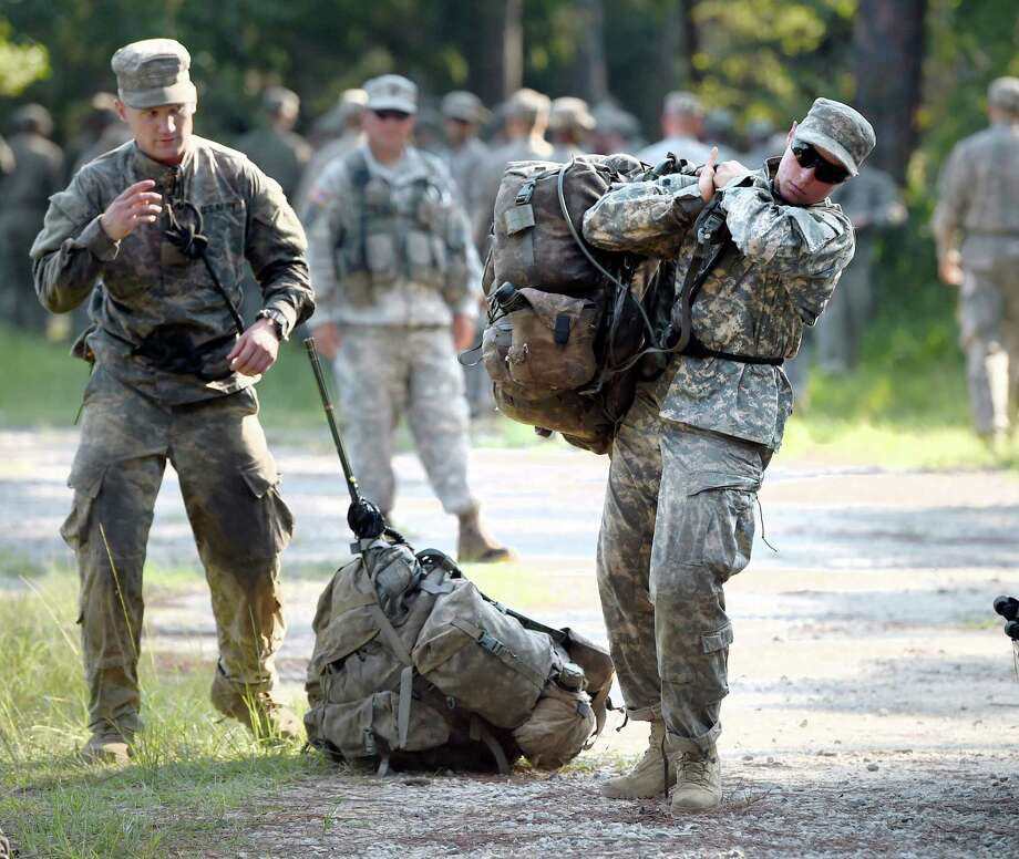 A female Army Ranger student lifts a rucksack onto her back on Tuesday, Aug. 4, 2015, at Camp James E. Rudder on Eglin Air Force Base, Fla. Two out of 19 females have made it to the final phase of Army Ranger training which ends at Camp James E. Rudder on Eglin Air Force Base. (Nick Tomecek/Northwest Florida Daily News via AP) Photo: Nick Tomecek, MBO / Associated Press / Northwest Florida Daily News