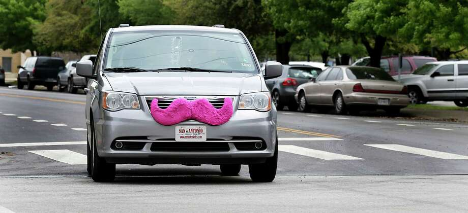 A LYFT car makes it's way down town with the signiture pink mustache. Thursday, March 27, 2014. Photo: BOB OWEN, Staff / San Antonio Express-News / © 2012 San Antonio Express-News