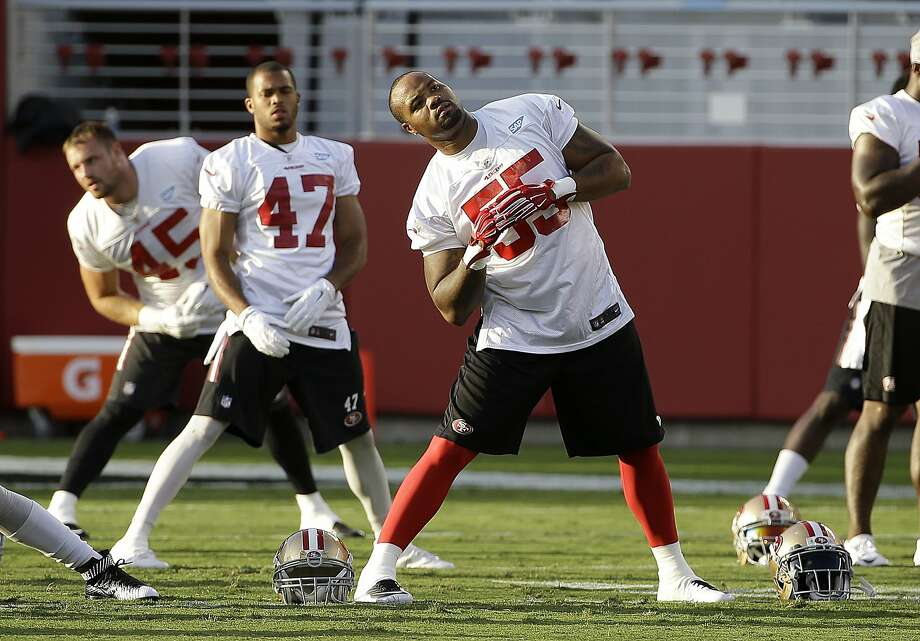 San Francisco 49ers linebacker Ahmad Brooks (55) stretches during the team's NFL football training camp in Santa Clara, Calif., Saturday, Aug. 1, 2015. (AP Photo/Jeff Chiu) Photo: Jeff Chiu, Associated Press