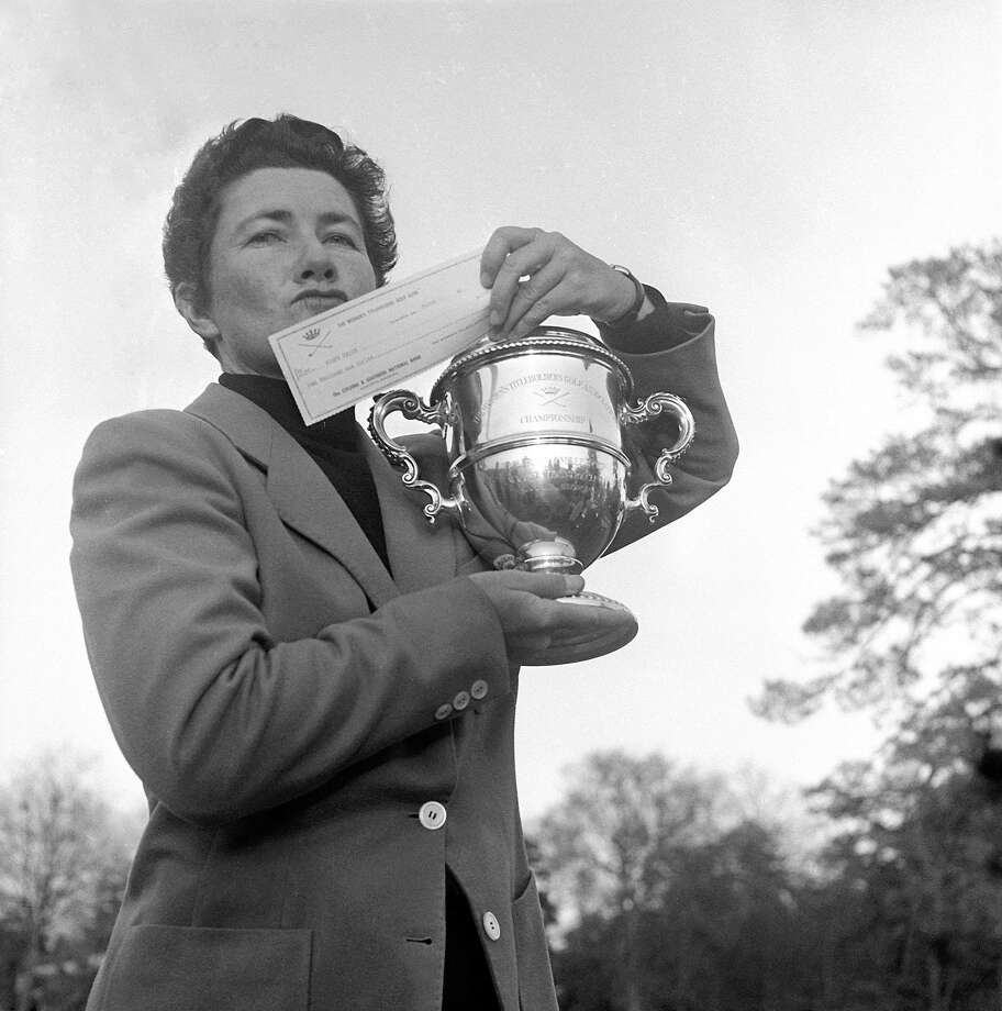 Louise Suggs is shown holding up a winner's check in 1959. Photo: Horace Cort, Associated Press