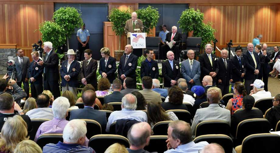 Living legends and members of the National Museum of Racing and Hall of Fame line the front of the Fasig Tipton sales pavilion during the induction ceremony for the new class of Hall of Famers Aug 7, 2015 in Saratoga Springs, N.Y.  (Skip Dickstein/Times Union) Photo: SKIP DICKSTEIN
