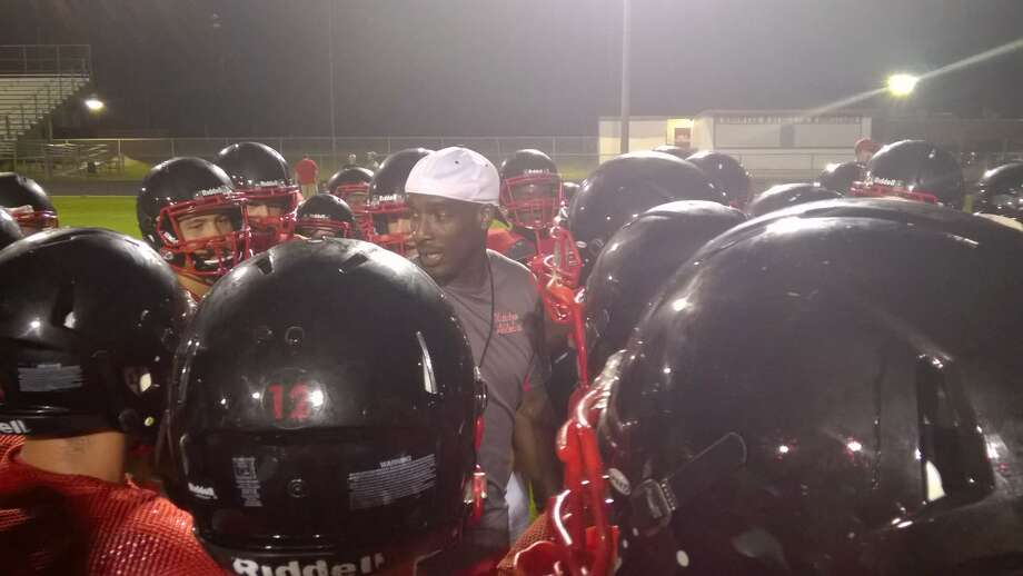 The Kountze Lions take part in their first Midnight Madness practice in school history in preparation for the 2015 season.