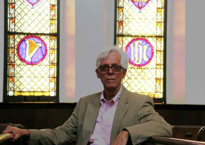 Gordon Boyd sits inside Bethesda Episcopal Church in Saratoga Springs. (Olivia Nadel/ Special to the Times Union)