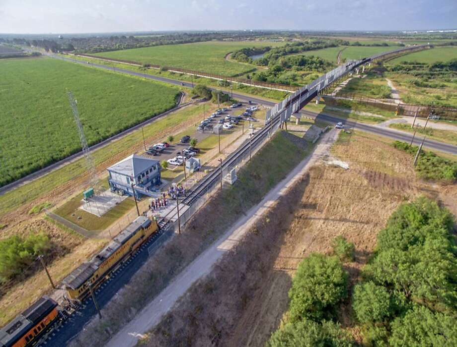 The West Rail Bridge crosses the Rio Grande west of Brownsville.  An aerial view shows the West Rail Bridge as it crosses the Rio Grande and into Mexico from the United States. The rail relocation project spanned 15 years and cost more than $120 million. It is the first U.S.-Mexico rail bridge in 100 years. Though international rail makse up a small part of goods that pass across the U.S. border with Mexico, regional business leaders say the bridge is key to the long-term success of the region. Photo: /Photo Courtesy Of Cameron County