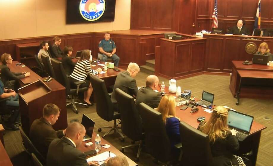 In this image made from Colorado Judicial Department video, James Holmes, top left in tan shirt, watches as Judge Carlos A. Samour, Jr., top right, prepares to read the jury's sentencing verdict in the Colorado theater shooting trial in Centennial, Colo., Friday, Aug. 7, 2015. (Colorado Judicial Department via AP, Pool) Photo: Associated Press