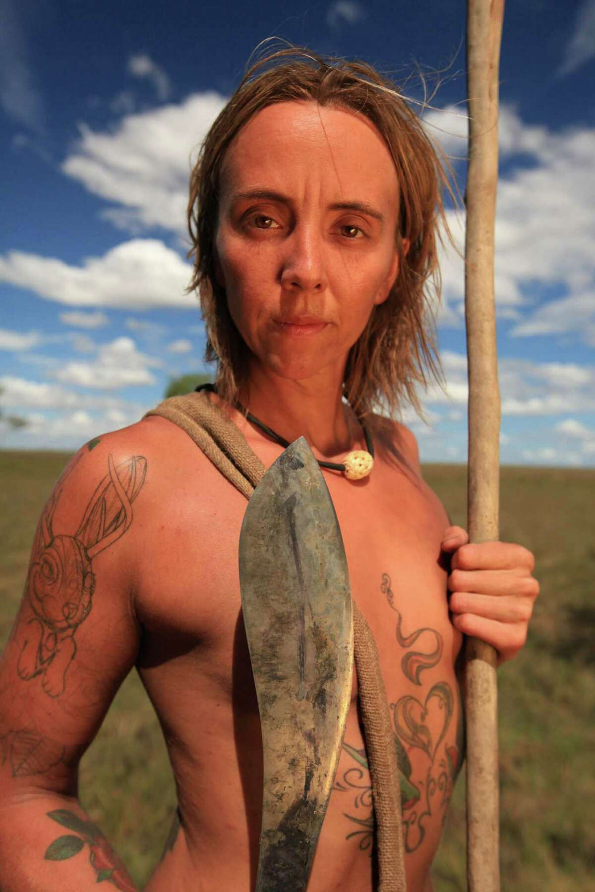 """Eva Rupert, who grew up in Bethel, holds a machete she used as a participant in the Discovery Channel's """"Naked and Afraid XL"""" challenge. The series airs Sundays at 10 p.m."""