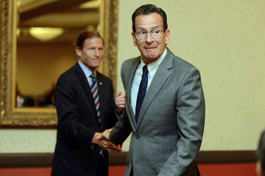 Gov. Dannel P. Malloy shakes hands with Sen. Richard Blumenthal Thursday at the Bridgeport Holiday Inn. Photo: Autumn Driscoll / Hearst Connecticut Media / Connecticut Post