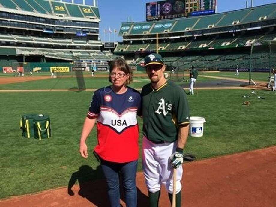 Abbey and Billy Burns, sister and brother. Abbey, a member of the U.S. Paralympic swim team, is throwing ceremonial first pitch before Friday night's Astros-A's game. Billy is the A's center fielder. Photo: Steve Kroner, The Chronicle