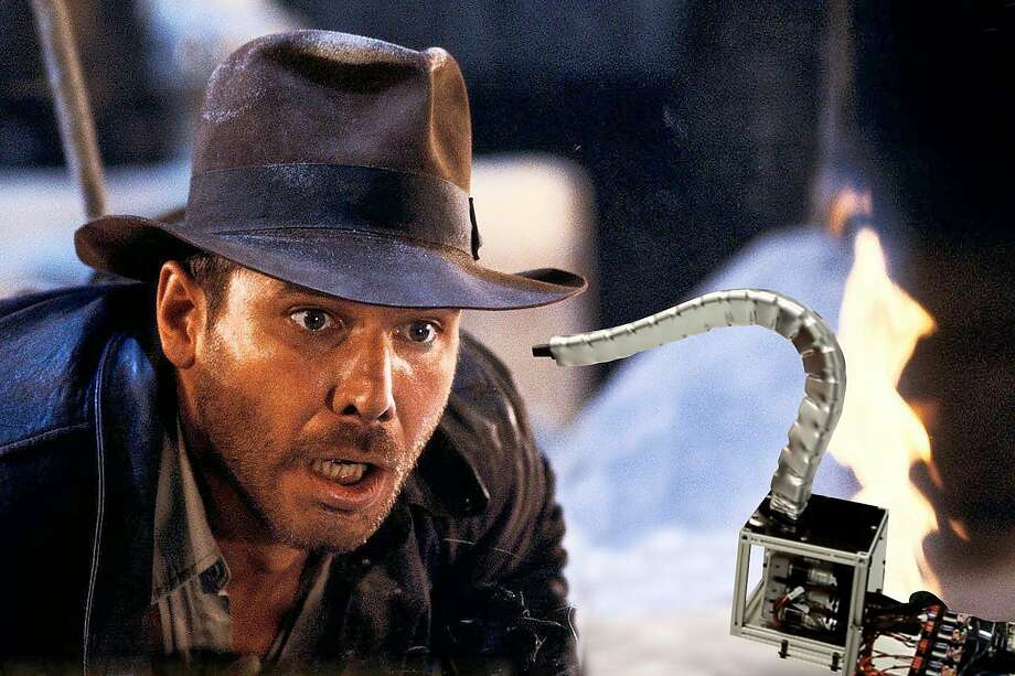 """Snakes. Why'd it have to be snakes?"" Indiana Jones said in ""Raiders of the Lost Ark."" He didn't comment on Tesla's ""Snakebot,"" but you can figure that somewhere, an archaeology professor's skin is crawling. Photo: The Chronicle Illustration"