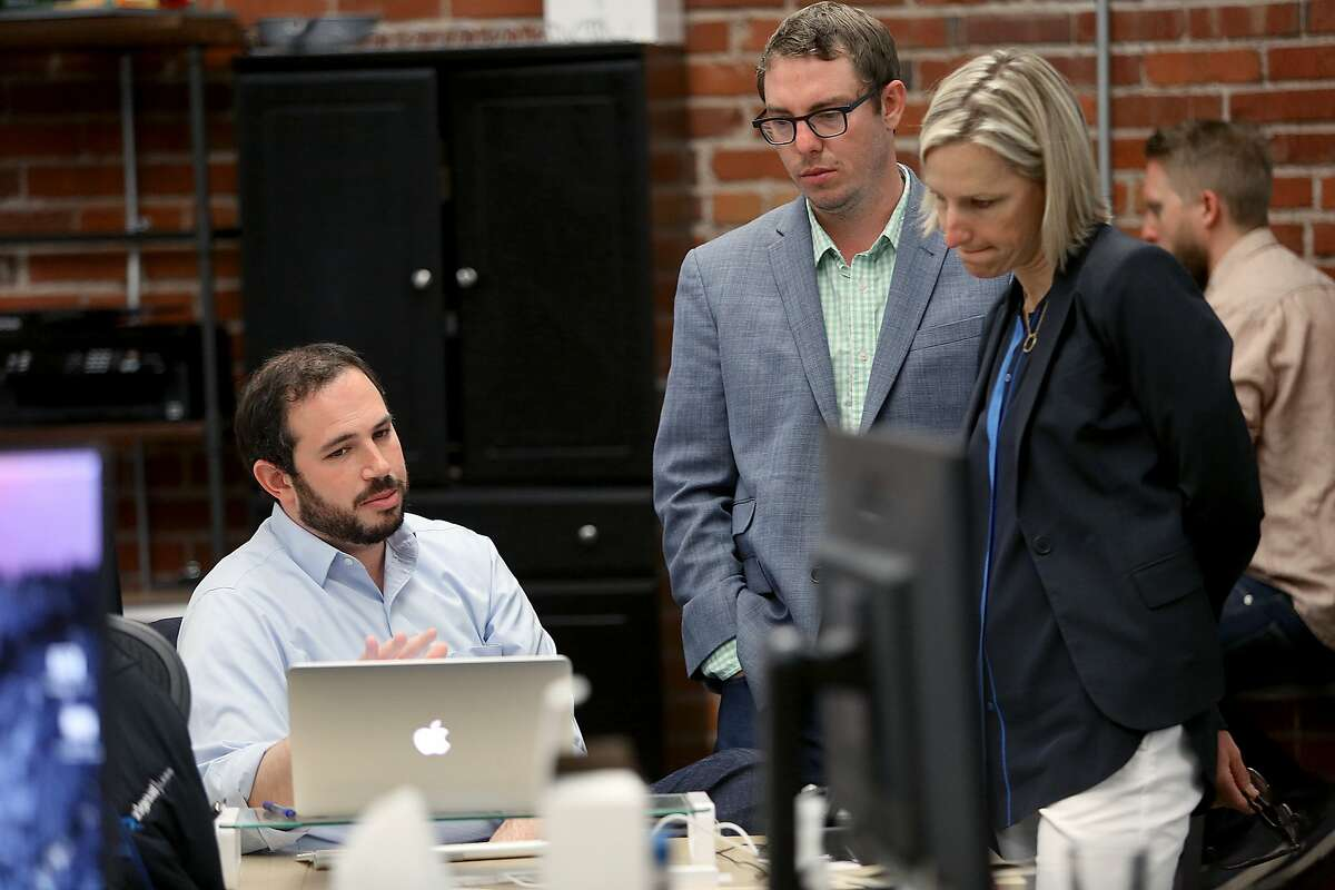 CEO and co-founder Josh Ginsberg (left), Adam Beaugh (middle) and VP of sales Alyson Welch (right) meet at Zignal in San Francisco, Calif., on Friday, August 7, 2015.