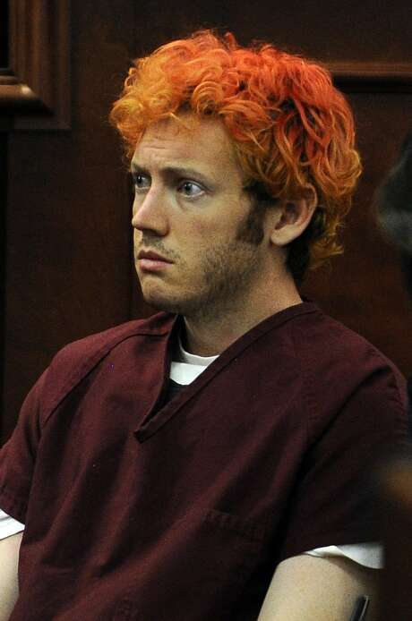 "(FILES) This July 23, 2012, file photo shows James Holmes appearing in court at the Arapahoe County Justice Center in Centennial, Colorado. A US jury on August 7, 2015, failed to agree on the death penalty for Holmes, who stormed a Colorado movie theater and killed 12 people, effectively condemning him to life in prison. The sentence will be formally imposed by a judge at a later hearing, but the jury said for each of the 12 counts: ""We the jury do not have a unanimous final sentencing verdict on this count and... understand the court will impose a sentence of life imprisonment without the possibility of parole.""        AFP PHOTO / POOL / RJ SANGOSTI / FILESRJ SANGOSTI/AFP/Getty Images Photo: RJ SANGOSTI, Pool / AFP / Getty Images / AFP"