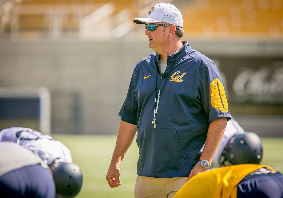 Cal coach Sonny Dykes runs football practice at Memorial Stadium. His fast-paced offense increases the time that the team's defense spends on the field. Photo: John Storey, Special To The Chronicle