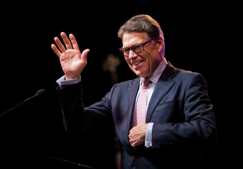Republican presidential candidate and former Texas Gov. Rick Perry, waves to the crowd as he steps to the podium to speak at the RedState Gathering, Friday, Aug. 7, 2015, in Atlanta. See the biggest donors to Perry's campaign for the GOP presidential nomination.  Photo: David Goldman, STF / AP