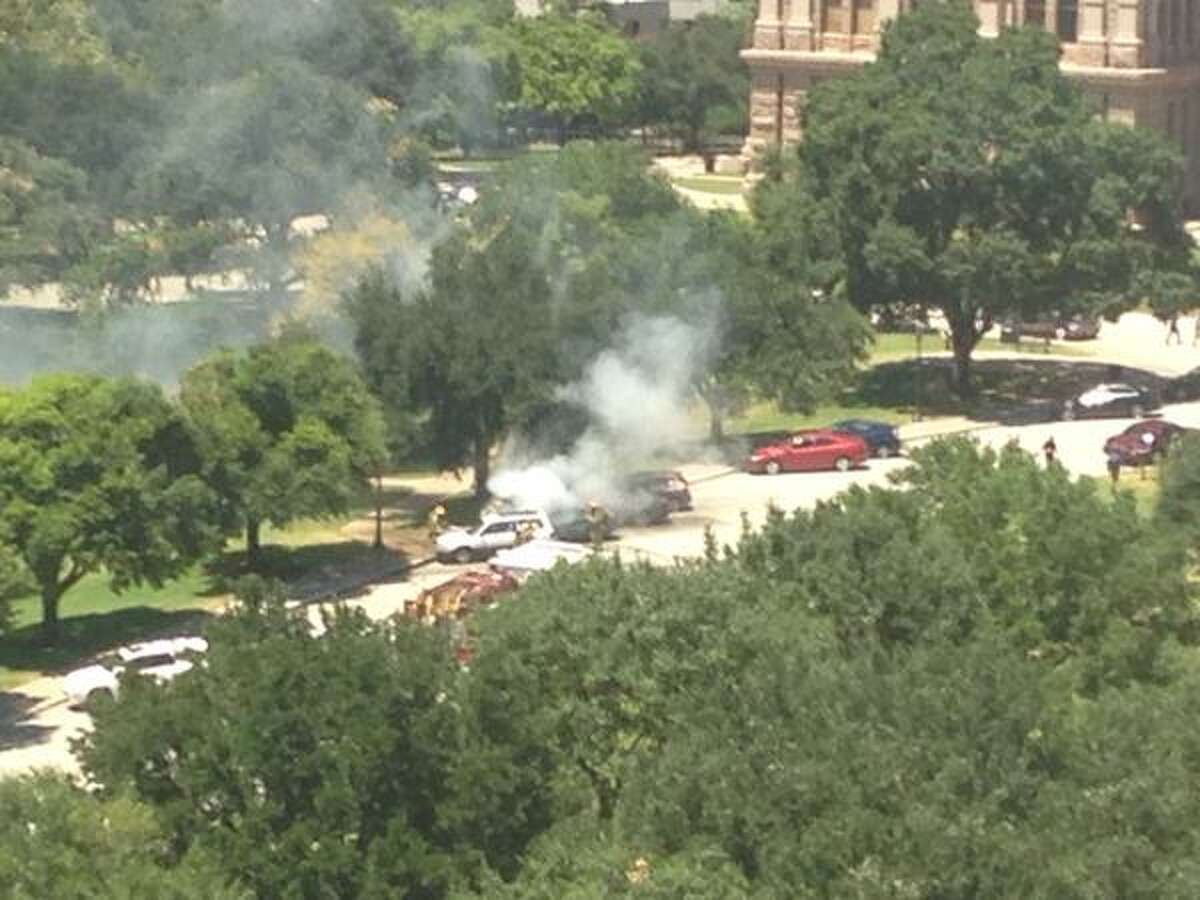 A car was found ablaze in front of the Texas Capitol in Austin on Friday, August 7, 2015. The fire was quickly extinguished by emergency personnel. (Photo by Lauren McGaughy)