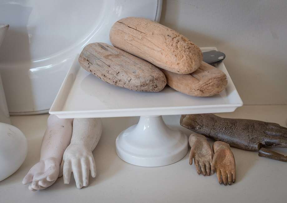 Noë covets quirky objects, like these wooden hands and blocks. Photo: John Storey, Special To The Chronicle