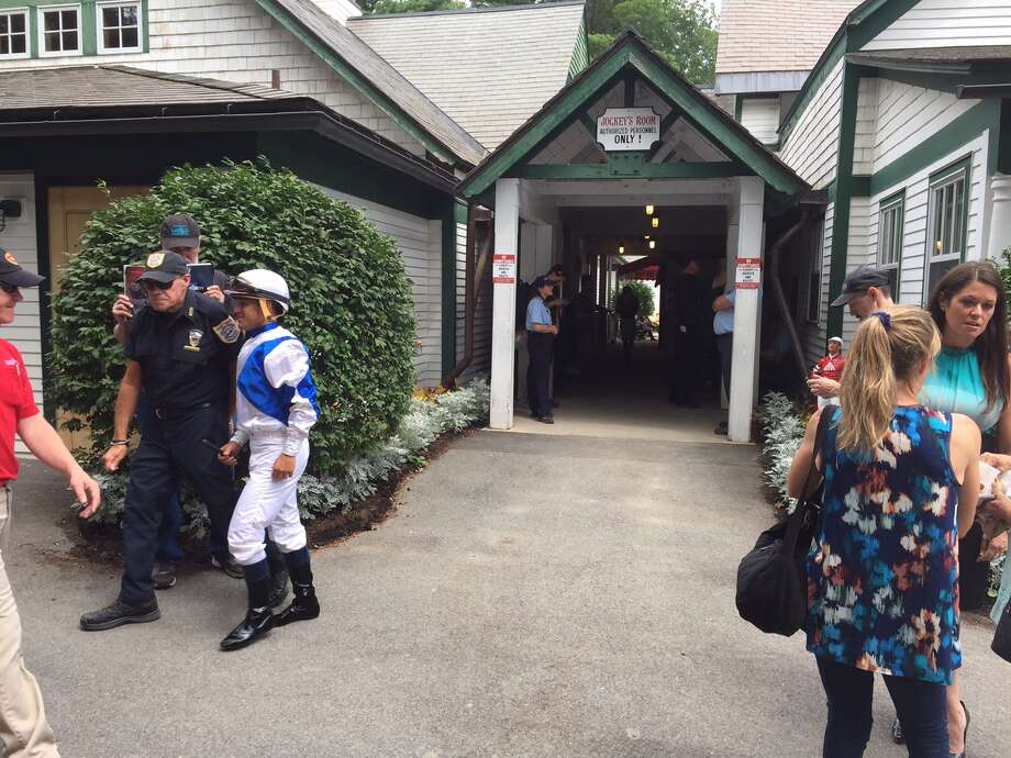 Javier Castellano, the two-time defending champion jockey at Saratoga, heads out of the jockeys' room before the third race on Friday. As the riders head to the paddock, they are stopped by kids who want to get their signatures. Been a Spa tradition for decades. There has been a cockamamie idea floating around that one day NYRA might move the jockeys' room to the paddock. That would ruin many a child's Saratoga experience of getting an autograph from their favorite jockey. Here's a piece of advice to NYRA: Don't do it. That is all. (Tim Wilkin / Times Union)