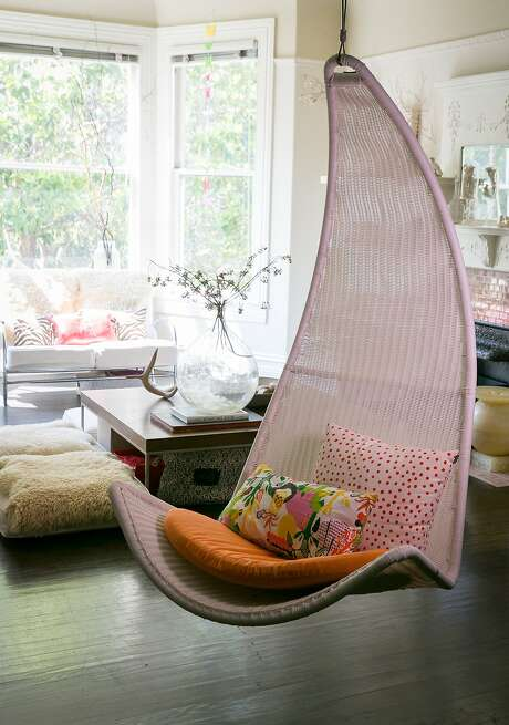A colorful swing seat in Leigh Noë's San Francisco flat. Photo: John Storey, Special To The Chronicle