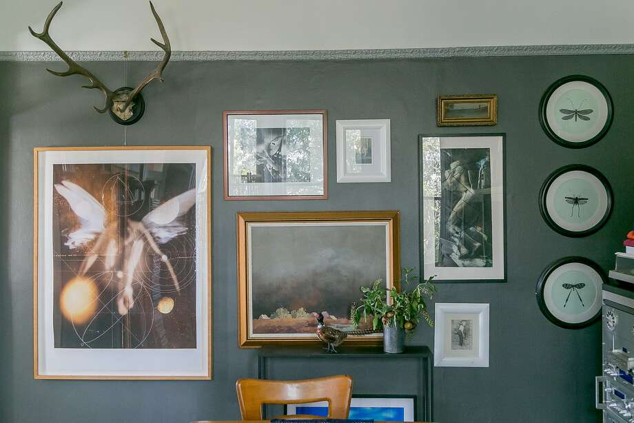 Fine art and antlers at Leigh Noë's S.F. home. Photo: John Storey, Special To The Chronicle