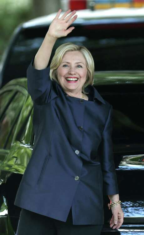 Presidential candidate and Democratic front-runner Hillary Clinton waves to supporters as she arrives at Club Giraud, on Wednesday June 3, 2015, for a fundraising mission for her presidential bid. Photo: Bob Owen, Staff / San Antonio Express-News / San Antonio Express-News