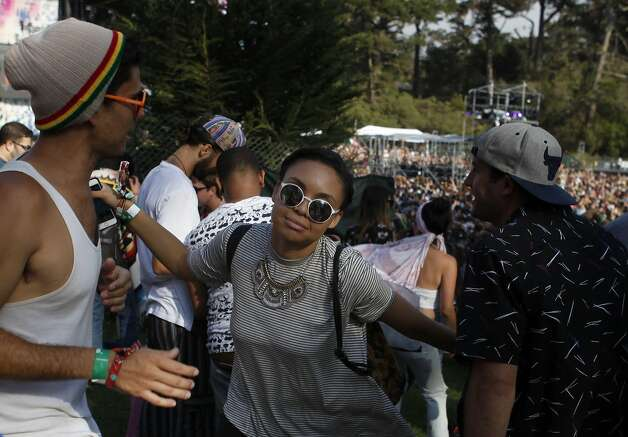 Misako Envela, 21, dances with her friends in front of Twin Peaks Stage at Outsidelands in San Francisco, California, on Saturday, May 30, 2015. Photo: Brandon Chew, The Chronicle