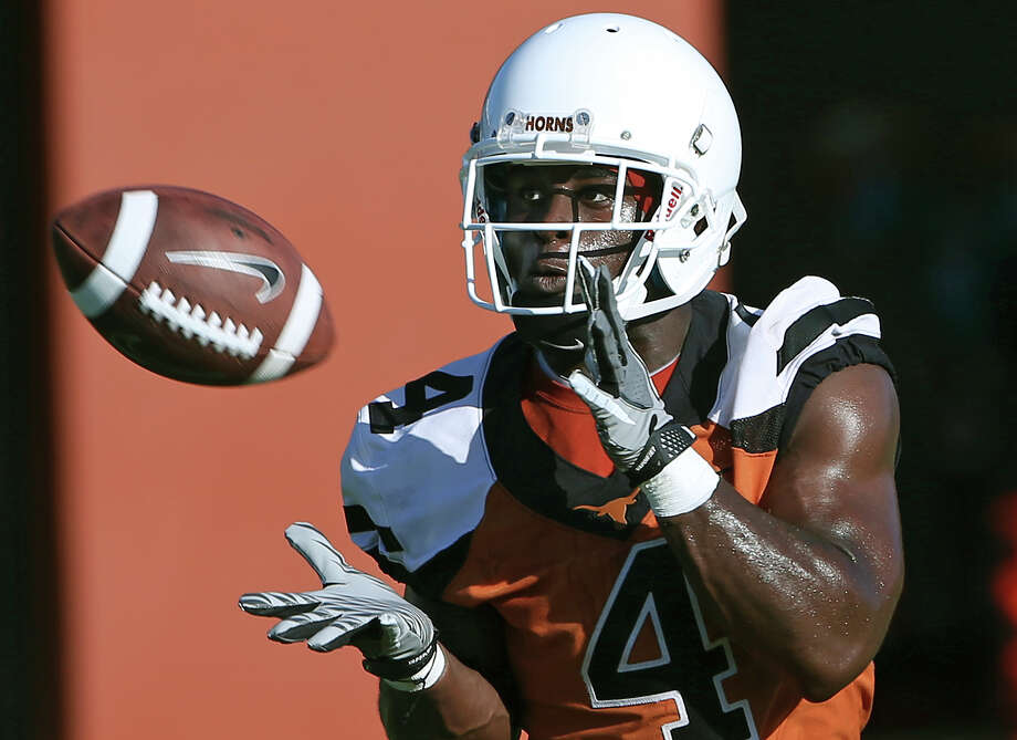 Daje Johnson makes a catch as the Longhorns hold their first football practice on August 7, 2015. Photo: Tom Reel / San Antonio Express-News