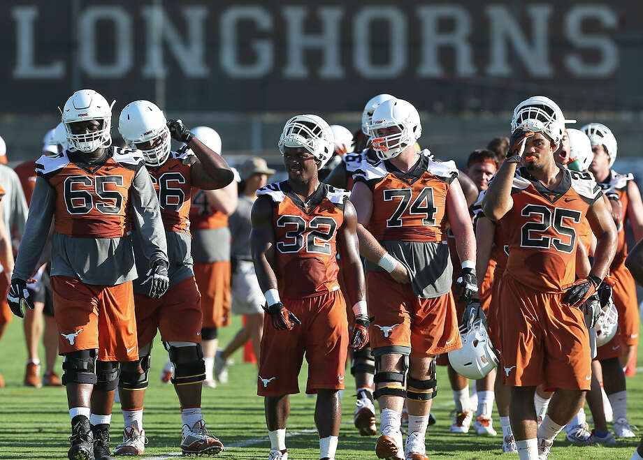 The Longhorns are coming off a disappointing 6-7 season, but they are optimistic going into Charlie Strong's second season. Photo: Tom Reel / San Antonio Express-News / San Antonio Express-News