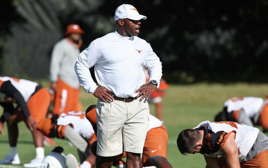 Coach Charlie Strong talks with his players as the Longhorns hold their first football practice on Aug. 7, 2015. Photo: Tom Reel /San Antonio Express-News