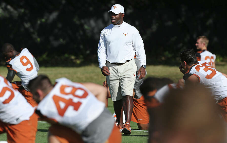 Coach Charlie Strong talks with his players as the Longhorns hold their first football practice on August 7, 2015. Photo: Tom Reel / San Antonio Express-News