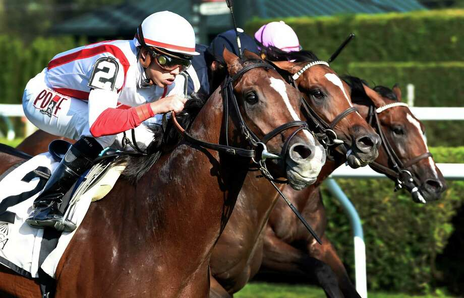 #2 Takeover Target with jockey Irad Ortiz Jr. aboard comes up on the outside to overtake the field to win the 31st running of The National Museum of Racing and Hall of Fame GII stake at the Saratoga Race Course Friday Aug 7, 2015 in Saratoga Springs, N.Y.  (Skip Dickstein/Times Union) Photo: SKIP DICKSTEIN