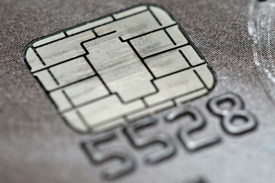 Even as an Oct. 1 deadline approaches to switch Americans over to credit cards embedded with chips, the vast majority still does not have the new cards and only some are using them as intended, a new Associated Press-GfK poll shows. Photo: Matt Rourke /Associated Press / AP