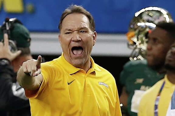 Baylor defensive coordinator Phil Bennett says the Bears' defense will be much improved in 2015.