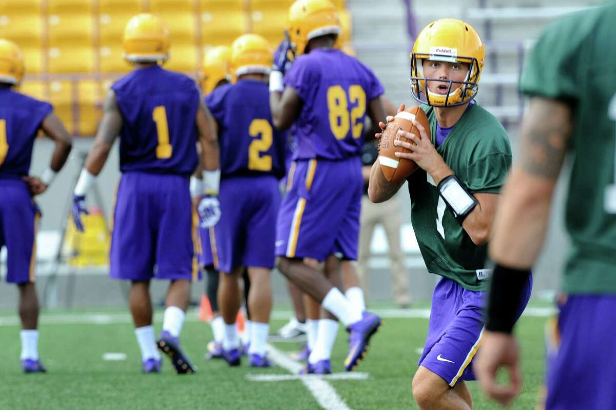 UAlbany quarterback Will Brunson, right, throws the ball during the first football practice of the season on Friday, Aug. 7, 2015, at UAlbany in Albany, N.Y. (Cindy Schultz / Times Union)