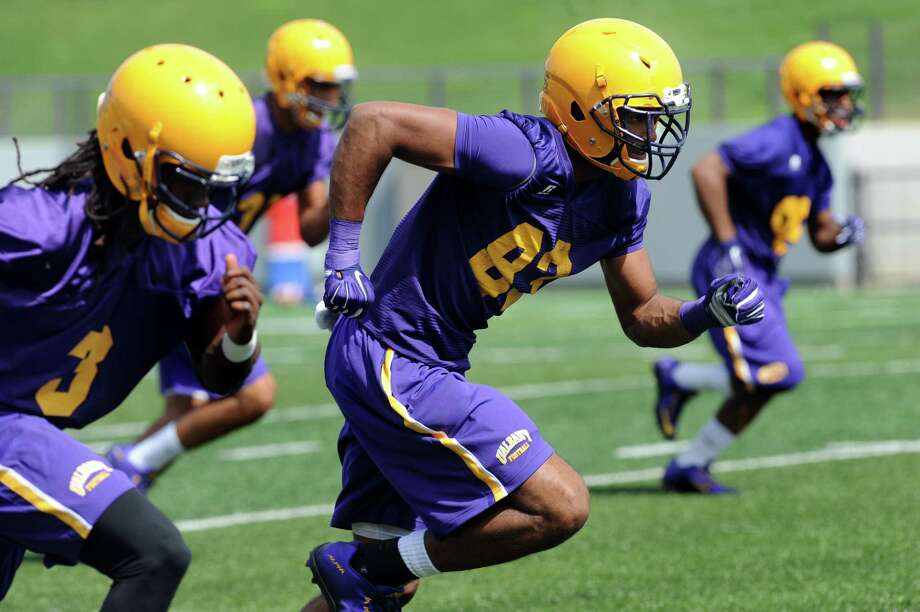 UAlbany's wide receivers Malachi Lawrence, left, and Josh Williams, center, run drills during the first football practice of the season on Friday, Aug. 7, 2015, at UAlbany in Albany, N.Y. (Cindy Schultz / Times Union) Photo: Cindy Schultz / 10032894A